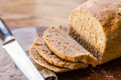 Whole Wheat Bread with Slices Stock Photos