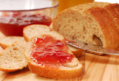 Whole wheat bread with strawberry jam Stock Photos