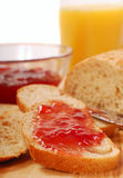 Whole wheat bread with strawberry jam Stock Images