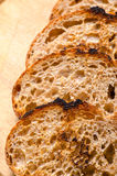 Whole wheat bread. Toasted slices on table Stock Photo