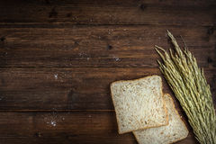 Whole wheat bread. Top view of whole wheat bread on wooden background with copyspace Stock Photo