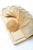 Whole wheat bread and wheat grains on white background Stock Image