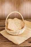 Whole wheat bread in the wooden basket Stock Photo