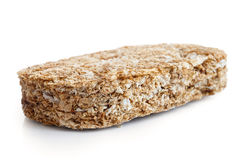 Whole wheat breakfast biscuit. Whole wheat breakfast biscuit isolated on white in perspective Royalty Free Stock Photo
