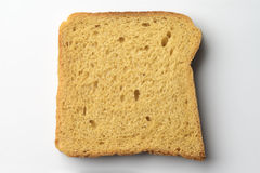 Whole wheat brown bread slice on white Royalty Free Stock Photos