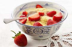 Whole wheat cereal with strawberries Royalty Free Stock Photography