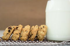 Whole wheat cookies. Close up of whole wheat cookies and a bottle of milk royalty free stock photos