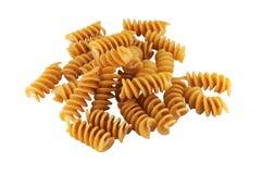 Whole wheat corkscrew pasta on white background royalty free stock photo