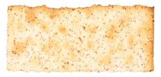 Whole Wheat Cracker. One wholesome whole wheat fiber cracker. Isolated on white Royalty Free Stock Image