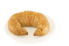 Whole wheat croissant. Picture of a whole wheat croissant on a plate stock photo