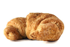 Whole wheat croissant on white. Part of a delicious continental breakfast: fresh baked healthy whole wheat croissant on white background Royalty Free Stock Photography