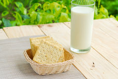Whole wheat flour crackers and milk Stock Photo