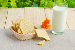 Whole wheat flour crackers and milk Stock Image