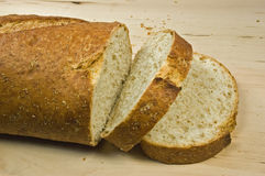 Whole wheat French bread. Fresh whole wheat french loaf with slices Stock Photography