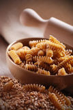 Whole wheat fusilli pasta Stock Photos