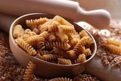 Whole wheat fusilli pasta Royalty Free Stock Images