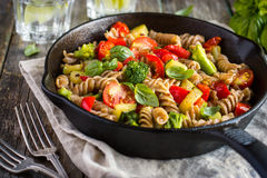 Whole wheat fusilli pasta  with vegetables Stock Photo