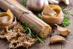 Whole wheat italian pasta with garlic and herbs Stock Image