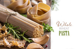 Whole wheat italian pasta with garlic and herbs Stock Images