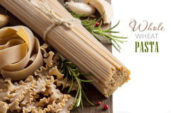 Whole wheat italian pasta with garlic and herbs Royalty Free Stock Images