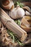 Whole wheat italian pasta with garlic and herbs Stock Photos