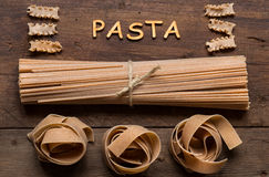 Whole wheat italian pasta and word Pasta Stock Images