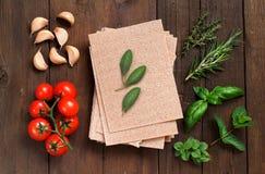 Whole wheat lasagna sheets, tomatoes, garlic and herbs Stock Image