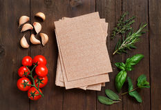 Whole wheat lasagna sheets, vegetables and herbs Royalty Free Stock Images