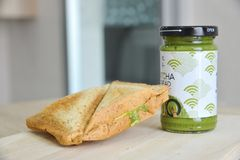 Whole wheat  matcha and cheese sandwich on a wooden board. Blur background Stock Photography