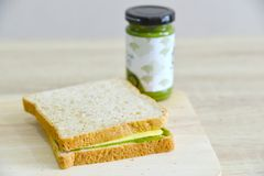 Whole wheat , matcha spread and cheddar cheese. Whole wheat bread and cheddar cheese on a wooden board Stock Photos
