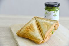 Whole wheat matcha spread and cheese sanwich. On a wooden board Royalty Free Stock Photography