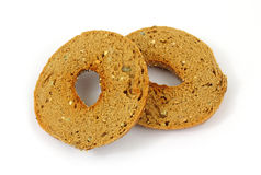 Whole wheat multi-grain bagel cut in half Stock Photos
