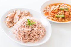 Whole wheat noodle with roast pork and som tum. On the table royalty free stock image