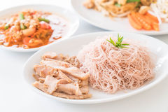 Whole wheat noodle with roast pork and som tum. On the table stock photography