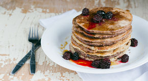 Whole wheat oatmeal pancakes with blackberry and syrup Royalty Free Stock Image
