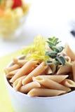 Whole wheat pasta. Bowl of whole wheat pasta tubes - detail Stock Image