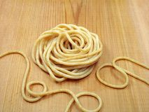 Whole Wheat Pasta. Cooked whole wheat pasta on cedar board stock images