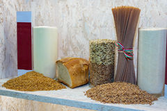 Whole Wheat Pasta, Seeds Assortment, Flours and Bread. Whole Wheat Pasta, Seeds Assortment, Flours inside Glass Vases and Bread Stock Photos