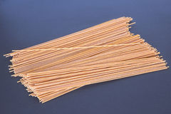 Whole Wheat Pasta. Whole wheat spaghetti pasta on a dark background Stock Image
