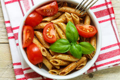 Whole wheat pasta with tomatoes, Basil, olive oil,  seasonings Stock Photo