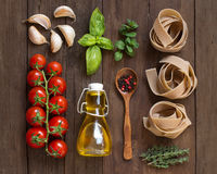 Whole wheat  pasta, vegetables,  herbs and olive oil Stock Image