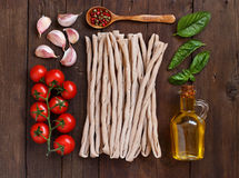 Whole wheat pasta, vegetables,  herbs and olive oil Stock Photography