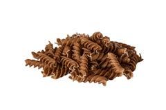 Whole wheat pasta on white background stock images