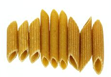 Whole wheat penne pasta Royalty Free Stock Images