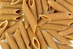 Whole wheat penne rigate pasta Stock Image
