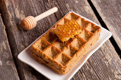 Whole wheat Pumpkin Waffles with honeycomb Royalty Free Stock Images