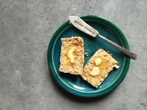 Whole wheat scone with melting butter on plate with knife Stock Photos