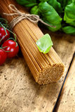 Whole wheat spaghetti Stock Images