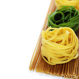 Whole wheat spaghetti and egg pasta nests Royalty Free Stock Images
