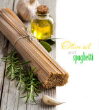 Whole wheat spaghetti, garlic, oilve oil and herbs Stock Images